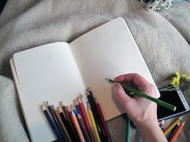 Pencils for drawing in a notebook. Write a congratulatory text in a notebook in colorful pencils Royalty Free Stock Photography
