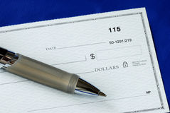 Write the dollar amount on the check. Isolated on blue stock photos