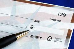 Write the dollar amount on the check Stock Photos