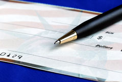 Write the dollar amount on the check Stock Photography
