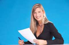 Write that down. Blonde businesswoman with file papers in her hand Royalty Free Stock Photo