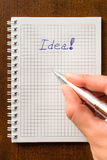 Write down an idea to notebook. Idea sign in notebook, i have an idea Stock Photo