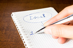 Write down an idea to the notebook. Idea sign in notebook, i have an idea! Write an idea Stock Images