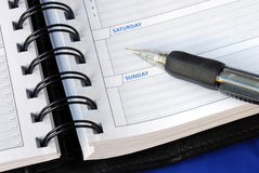 Write down the notes for the weekend Royalty Free Stock Photo