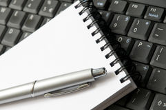 Write equipament. Pen, notepad and laptop Royalty Free Stock Photography