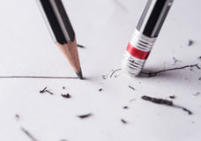 Write and erase. Close up of a sharpened pencil writing a straight line royalty free stock photos