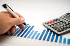 Write financial graphs analysis. Write financial accounting concept with graphs and charts Royalty Free Stock Photos