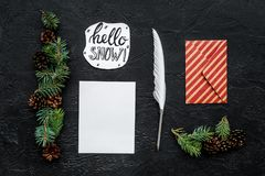 Write greetings. Envelope, paper, pen, hello snow hand lettering on black background top view pattern. Write greetings. Envelope, paper, pen, hello snow hand Stock Photos