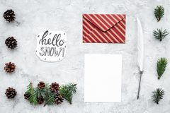 Write greetings. Envelope, paper, pen, hello snow hand lettering on grey background top view pattern. Write greetings. Envelope, paper, pen, hello snow hand Royalty Free Stock Photos