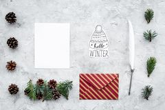 Write greetings. Envelope, paper, pen and hello winter hand lettering on grey background top view pattern. Write greetings. Envelope, paper, pen and hello winter Royalty Free Stock Photos