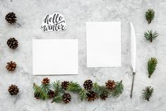 Write greetings. Envelope, paper, pen and hello winter hand lettering on grey background top view pattern. Write greetings. Envelope, paper, pen and hello winter Stock Image