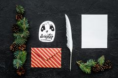 Write greetings. Envelope, paper, pen and winter hand lettering on black background top view pattern. Write greetings. Envelope, paper, pen and winter hand Royalty Free Stock Images