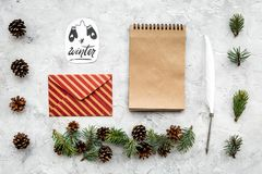 Write greetings. Envelope, paper, pen and winter hand lettering on grey background top view pattern. Write greetings. Envelope, paper, pen and winter hand Royalty Free Stock Images