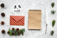 Write greetings. Envelope, paper, pen and winter hand lettering on grey background top view pattern. Write greetings. Envelope, paper, pen and winter hand Royalty Free Stock Photography