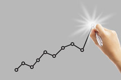 Write growing earning graph Stock Image
