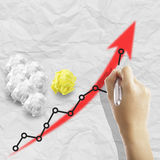Write growing earning graph Royalty Free Stock Photo