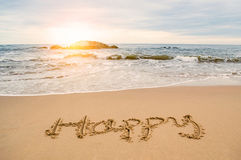 Write happy on beach royalty free stock photo