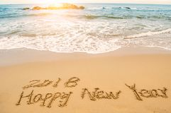 Write happy new year 2018 on beach. Word 2018 happy new year write on beach stock photos