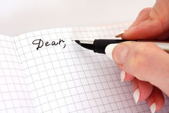 Write letter. Hand with pen writing a letter Stock Photo