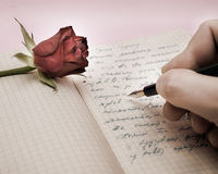 Write a love letter with a rose. Over pink background Stock Photo