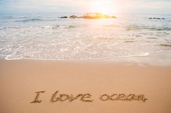 Write love ocean on beach Royalty Free Stock Images