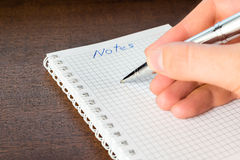 Write a note in the notebook Royalty Free Stock Images
