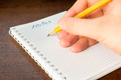 Write a note in the notebook Stock Photography