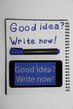 Write now good idea, write in a notebook. Good idea write now Stock Image