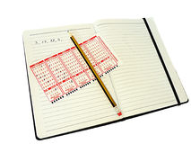 Write the numbers in a pencil notebook Stock Photo