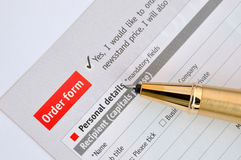 Write on order form. A golden pen putting on order sheet, shown as successful selling or business purchase, or satisfied customer and continued order Royalty Free Stock Photo