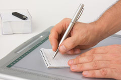 Write with a pen in a notebook Stock Image