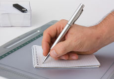 Write with a pen in a notebook Stock Photos