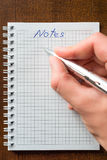 Write with a pen in a notebook Royalty Free Stock Photo