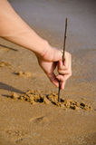 Write on the sand Royalty Free Stock Photo