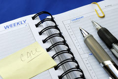 Write some notes on the day planner. Write down some notes on the day planner royalty free stock image