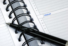 Write some notes on the day planner. Write down some notes on the day planner royalty free stock images