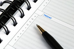 Write some notes on the day planner. Writing some notes on the day planner stock image