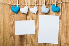 Write some words of love. Blank sheet of paper hand made heart pinned to rope on wooden background Stock Photos