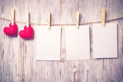 Write some words of love. Blank sheet of paper hand made heart pinned to rope on wooden background Stock Photo
