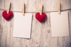 Write some words of love. Blank sheet of paper hand made heart pinned to rope on wooden background Royalty Free Stock Images