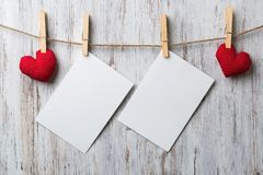 Write some words of love. Blank sheet of paper hand made heart pinned to rope on wooden background Royalty Free Stock Photos