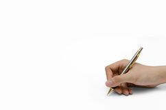 Write something. A hand holding a pencil to write something Stock Image