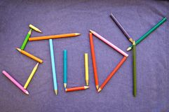 Write a study written in colored pencils. stock photo