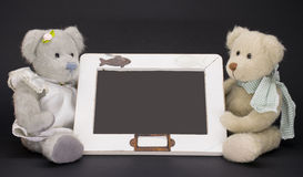 Write with teddy bear. A couple of teddy bear near a blackboard where you can write anything Royalty Free Stock Photography