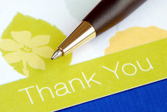 Write the thank you card. Isolated on blue Stock Image
