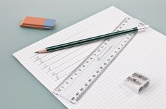 Write training supplies on a white paper. With some handwrited single letters Stock Photos