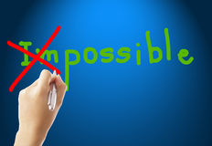 Write turn word impossible to possible with your hand Royalty Free Stock Photo