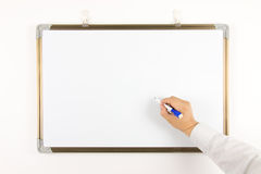 Write on the whiteboard. Hand write on the whiteboard Stock Image