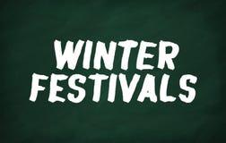 Write Winter festivals. On the blackboard with chalk write Winter festivals Stock Image