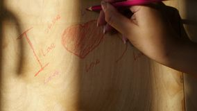 Write on a wooden board with crayons declaration of love, 4k stock video footage